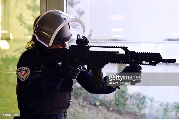 A French anticrime brigade officer makes a shooting simulation with a new German HK G36 assault rifle during a presentation of the new equipment for...