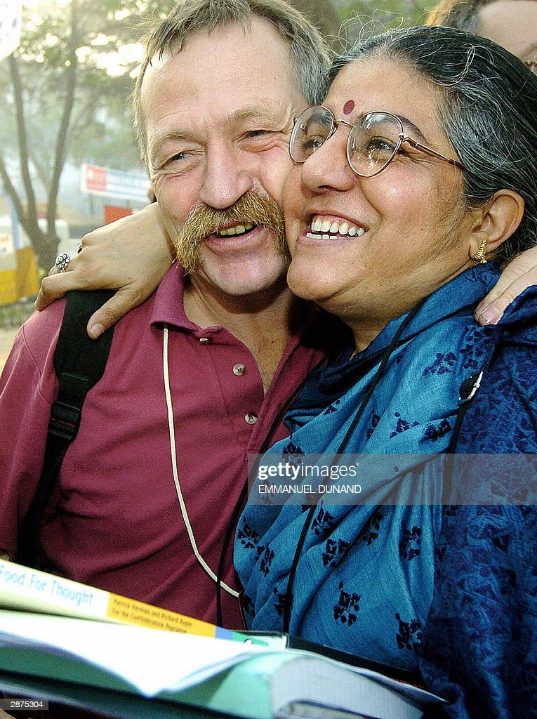 French antiglobalisation activist Jose Bove and India's leading ecologist activist Vandana Shiva hug each other at the 2004 World Social Forum in...