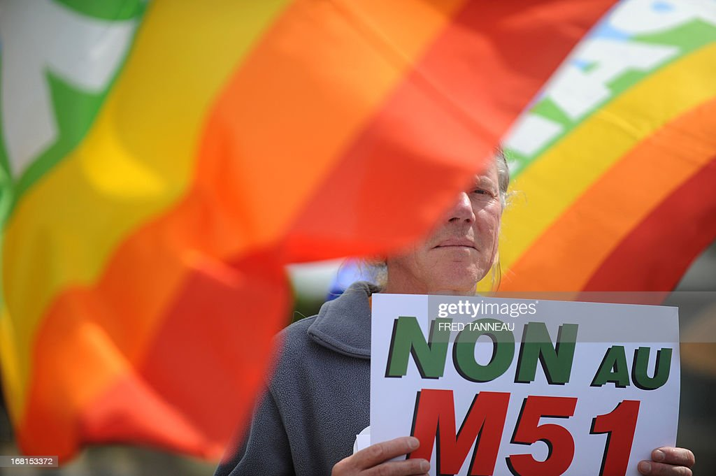 A French anti-nuclear activist holdsa banner during a protest, on May 6, 2013, in Penmarch, western France, a day after a French test of an M51 submarine-launched ballistic missile failed as it self-destructed off the coast of Brittany. The missile was test fired, without a nuclear warhead, from the Vigilant -- a strategic nuclear submarine -- from the Bay of Audierne and had been due to go down in the isolated north Atlantic. TANNEAU