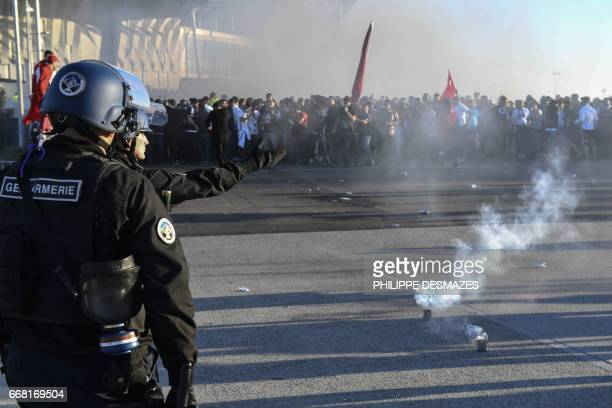 French antiriot Gendarmes containt Besiktas supporters during clashes outside the Parc Olympique Lyonnais stadium prior to the UEFA Europa League...