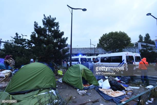 French antiriot police force CRS officers prepare the evacuation of a makeshift camp at Porte de la Chapelle in the north of Paris on August 18 2017...