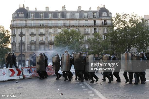 French antiriot police forces clash with antifascists demonstrating in Paris on April 23 2017 following the announcement of the results of the first...