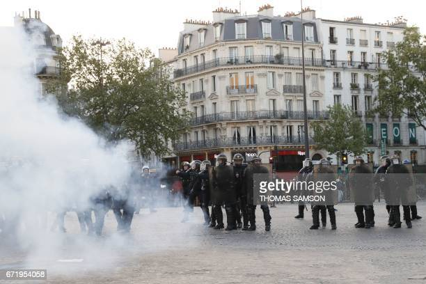 French antiriot police forces clash with antifascists during a demonstration in Paris on April 23 2017 following the announcement of the results of...