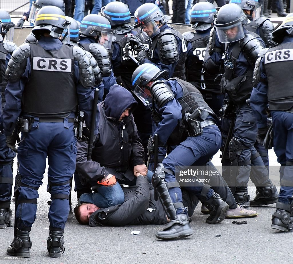French anti-riot police intervene to protestors during a protest against the French government's proposed labour reforms at the Place de la Nation in Paris, France on April 28, 2016. Protesters clashed with police in Paris and western France on April 28 as workers and students across the country made a new push for the withdrawal of a hotly contested labour bill.
