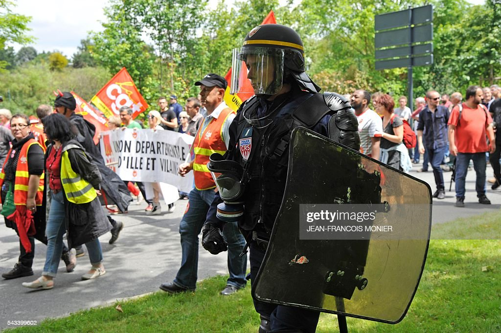 A French anti-riot police officer patrols during a demonstration against controversial labour reforms on June 28, 2016 in Rennes. Unions have called repeated strikes and marches in opposition to the law, which seeks to bring down France's intractable 10-percent unemployment rate by making it easier to hire and fire workers.