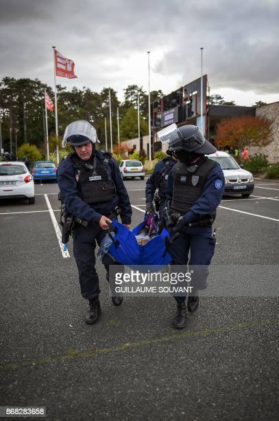 French antiriot police officers evacuate a victim on a stretcher during an exercise simulating a terrorist attack inside the theatre Espace Malraux...