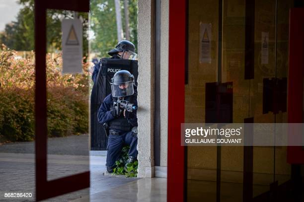 French antiriot police officers stand guard as they prepare an evacuation of the hostages during an exercise simulating a terrorist attack inside the...