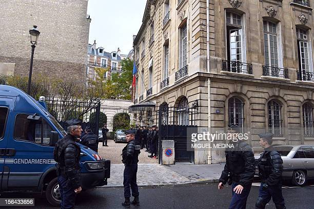 French antiriot policemen block the entrance of the French Strategic analysis center on November 15 2012 in Paris as activists of the 'collectif des...