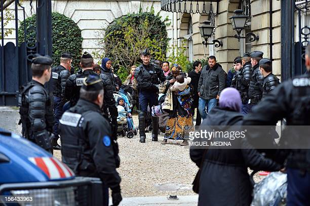 French antiriot policemen evacuate activists of the 'collectif des mallogés en colère' from the French Strategic analysis center on November 15 2012...