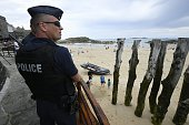French antiriot policemen patrol close to the beach of SaintMalo western France on July 21 2016 French lawmakers voted massively on July 20 to extend...