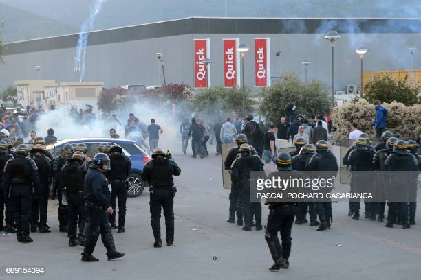 French antiriot policemen scatter Bastia's supporters outside the stadium after the French L1 football match Bastia vs Lyon on April 16 2017 in the...