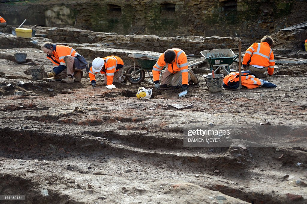 French archaelogists of Inrap (Institut national de recherches archeologiques preventives) dig a 8,000 SQM area on the site of a former convent on February 11, 2013 in the city center of Rennes, western France. The remains of a Gallo-Roman temple and 550 medieval and modern burials, including several lead sarcophagus, were unearthed during archaeological excavations on the site of the future Palais des Congres (Congress Center). AFP PHOTO / DAMIEN MEYER