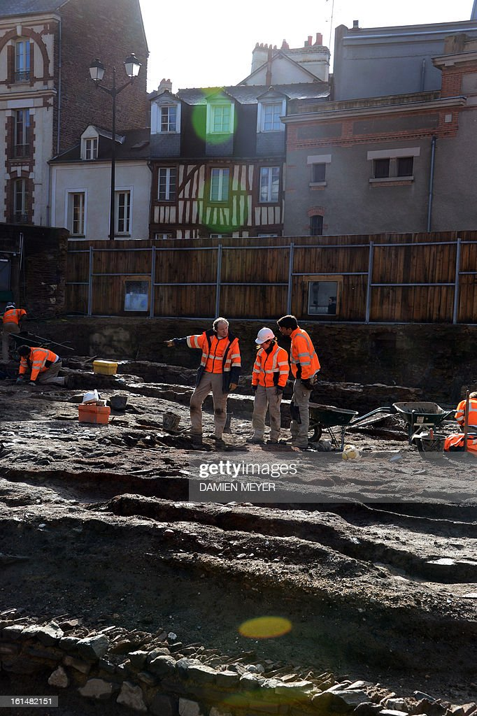 French archaelogists of Inrap (Institut national de recherches archeologiques preventives) dig a 8,000 SQM area on the site of a former convent on February 11, 2013 in the city center of Rennes, western France. The remains of a Gallo-Roman temple and 550 medieval and modern burials, including several lead sarcophagus, were unearthed during archaeological excavations on the site of the future Palais des Congres (Congress Center).