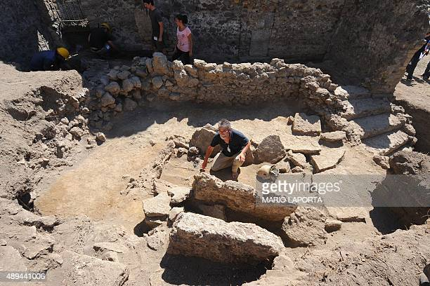 French archaeologist Henri Duday of National Center for Scientific Research shows a Samnite tomb of the fourth century BC with a woman's skeleton and...