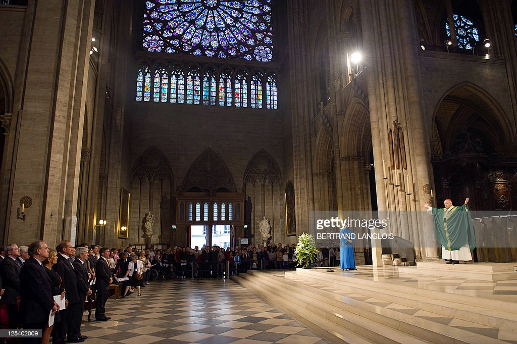 French archbishop Andre Vingt-Trois (R) celebrates a mass in memory of the victims of the 9/11 attacks at the Notre Dame cathedral in Paris on September 11, 2011. French culture minister Frederic Mitterrand (L), French defence minister Gerard Longuet (3rdL) and US ambassador to France Charles Rivkin (4thL) attend the mass. Several commemorations are held in France today to mark the 10th anniversary of the 9/11 attacks which killed almost 3,000 people in NYC and Washington and plunged the US into an era of war.