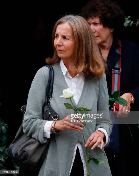 French architect and French actor Jean Rochefort's wife Françoise Vidal leaves after a funeral ceremony for late French actor Claude Rich at the...
