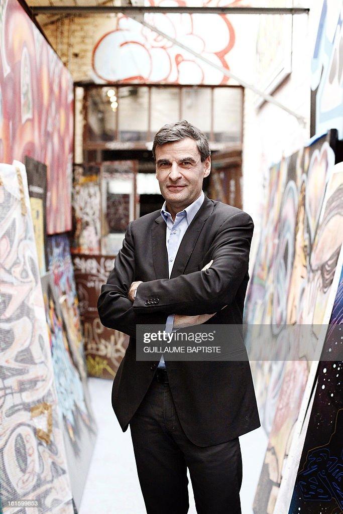 French architect and Graffiti art patron Alain-Dominique Gallizia poses on February 12, 2013 at his studio 'L'Atelier de l'Art sauvage' in Boulogne-Billancourt, near Paris.