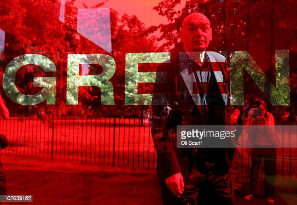 French architect Jean Nouvel is viewed through a red glass window in the 10th Serpentine Gallery Pavilion which he designed on July 6 2010 in London...