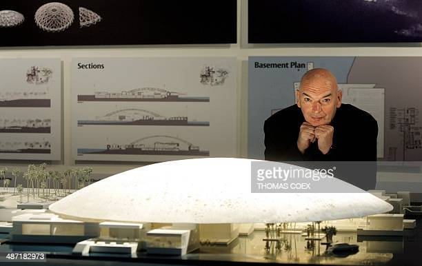 French architect Jean Nouvel poses next to the model of the futur Louvre Abu Dhabi museum after a signing ceremony about a controversial agreement to...