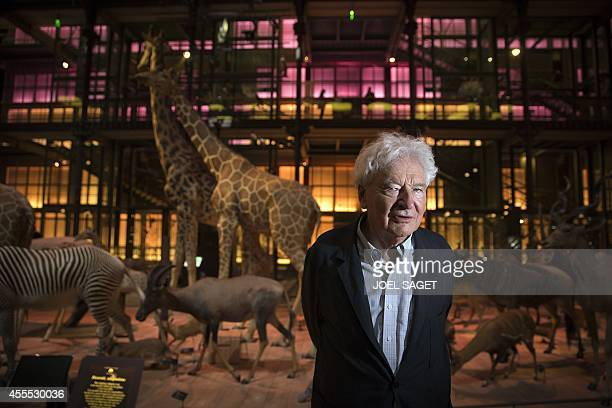 French architect Paul Chemetov poses on September 16 2014 next to stuffed animals in the Evolution's great gallery of the Museum of Natural History...