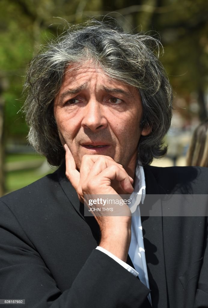 French Architecte Rudy Ricciotti attends the inauguration of the La Boverie museum on May 4, 2016 in Liege. The new museum La Boverie was inaugurated today, with an exhibition organised in partnership with Le Louvre museum. / AFP / JOHN