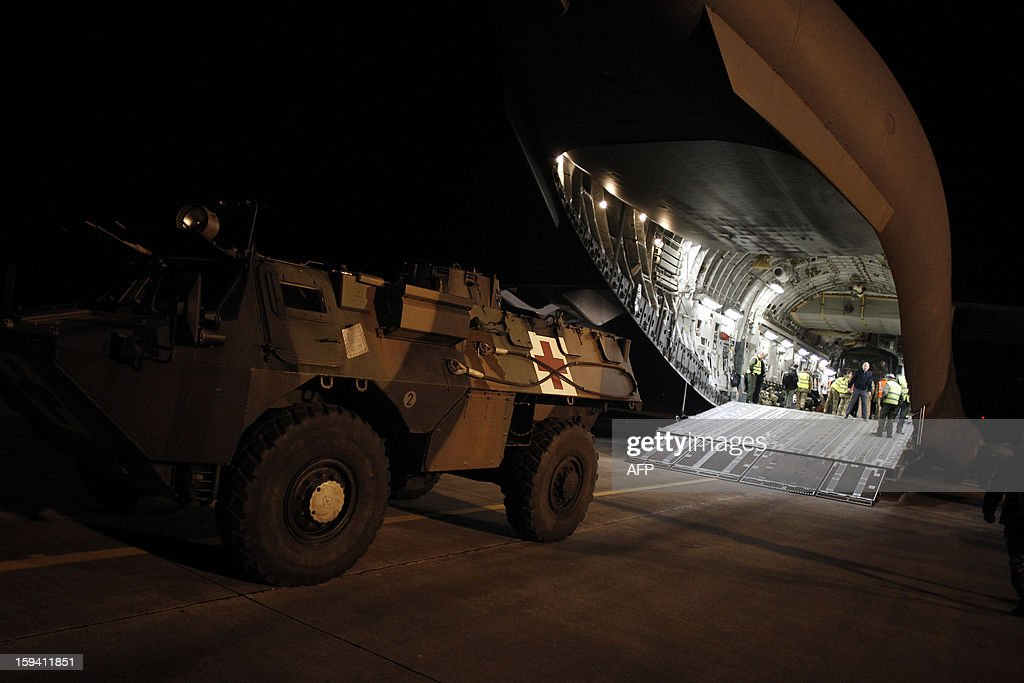 A French armoured vehicle is load in a British army Boeing C-17 cargo aircraft arriving from British Brize Norton base en route to Bamako, on January 13, 2013 at the Evreux military Base. Britain supports France's decision to send troops to support an offensive by Mali government forces against Islamist rebels. AFP PHOTO CHARLY TRIBALLEAU
