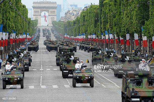 French Army armoured vehicle of the Etat Major de Force 1 drive down the ChampsElysees avenue during the annual Bastille Day military parade in Paris...