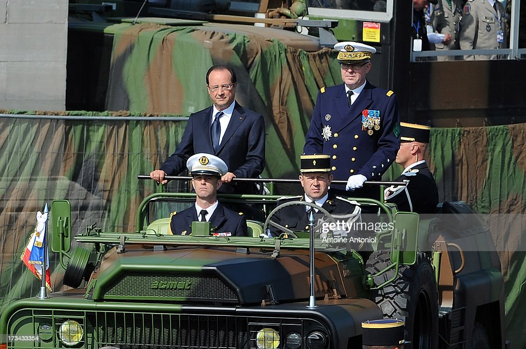 French Army Chief of Staff Admiral Edouard Guillaud and French President Francois Hollande arrive at the Bastille Day parade on the Champs Elysees on July 14, 2013 in Paris, France. The annual military ceremony is the largest in Europe remembering the 'Fete de la Federation' for 1790.