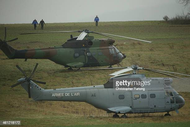 French Army helicopters wait in a field surrounding an industrial estate where it is thought the suspects linked to the Charlie Hebdo massacre are...
