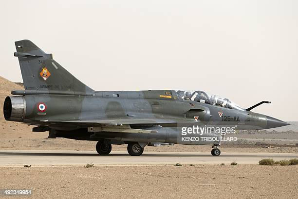A French army Mirage 2000 fighter jet prepares to take off on October 12 as the French Prime Minister and the Defence Minister visit an army base in...