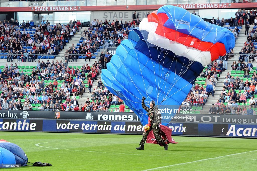 French army Parachutist lands on the field with the ball before the French L1 football match between Rennes and Guingamp on April 12, 2015 at the route de Lorient stadium in Rennes, western France.