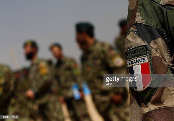 A French Army patch is seen as soldiers from the Afghan National Army leave after watching training exercises and tactical manoeuvres operated by the...
