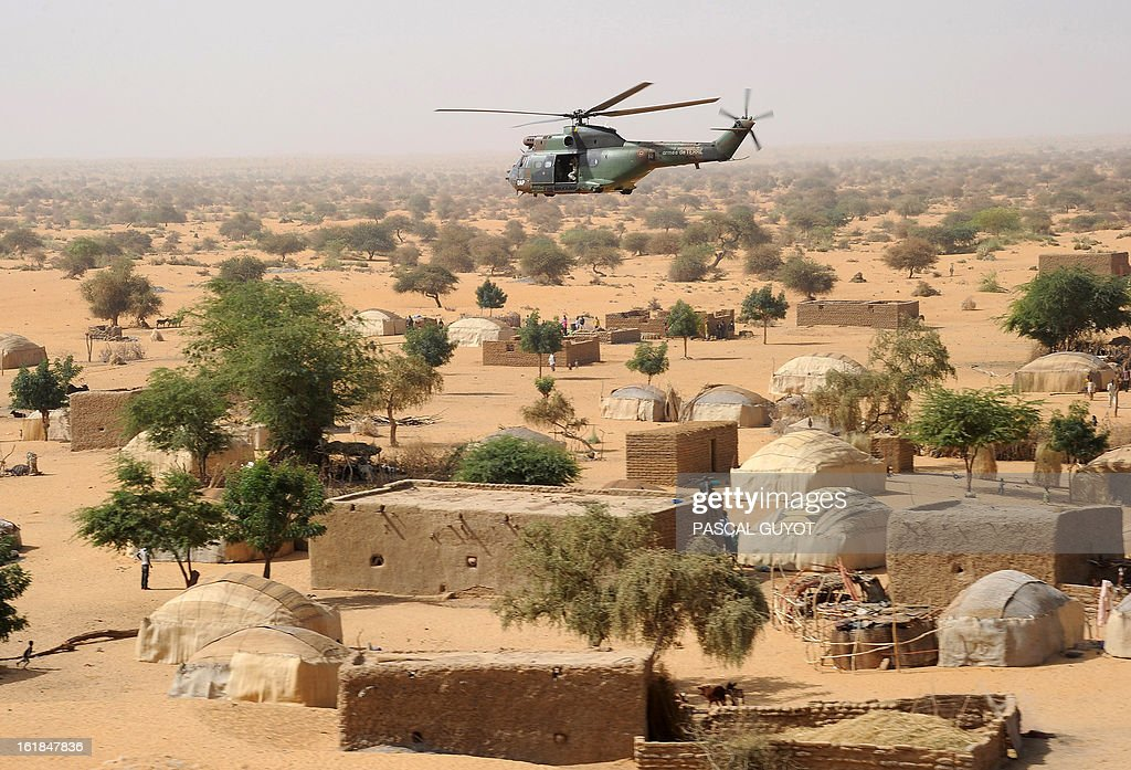 A French army Puma helicopter flies over a village on February 17 2013 between Gao and Bourem northern Mali Leaders in Africa's Sahel region called...
