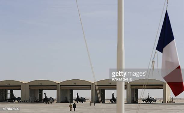 French army Rafale fighter jets sit on the tarmac at a military base at an undisclosed location in the Gulf on November 17 as the French army...