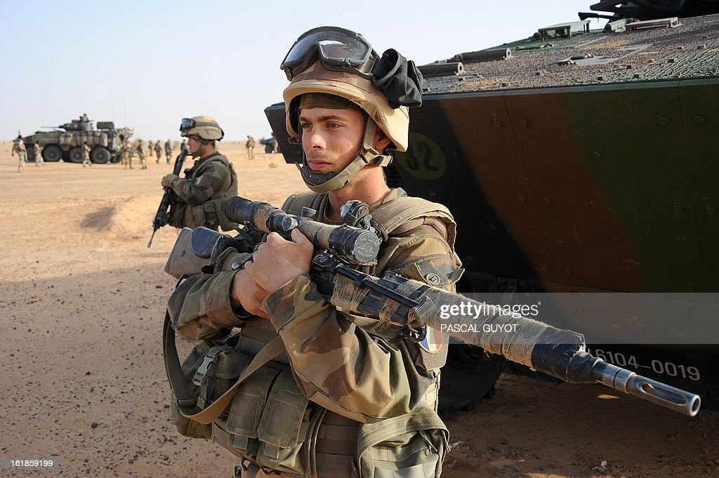 A French army sniper stands in the desert near the city of Bourem, northern Mali, on February 17, 2013. A French-led military intervention launched on January 11 has driven the Islamist rebels in Mali from the towns they controlled, but concerns remain over stability amid suicide attacks and guerrilla fighting.