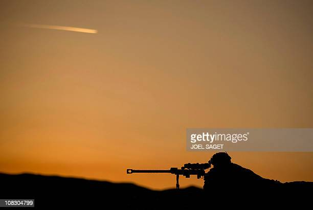 A French army soldier of the 2nd RIMA watches through the scope of a PGM heavy sniper rifle near the Forward Operating Base Tora in Surobi province...