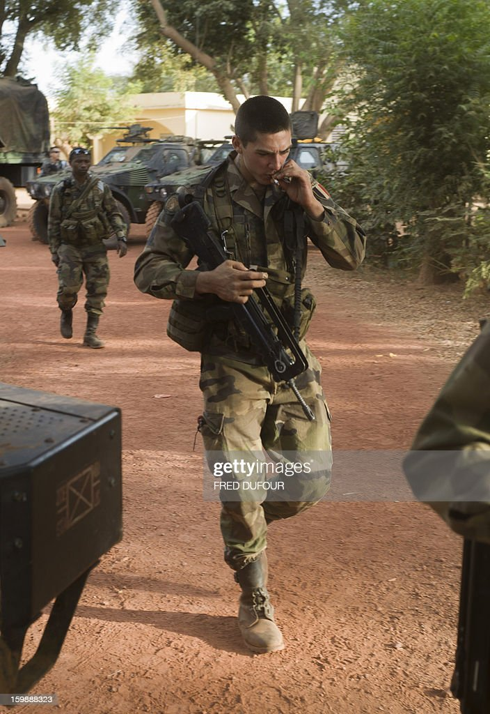A French army soldier smokes a cigarette as he prepares to leave a base camp in Sevare, on January 22, 2013. Mali's army chief today said his French-backed forces could reclaim the northern towns of Gao and fabled Timbuktu from Islamists in a month, as the United States began airlifting French troops to Mali.