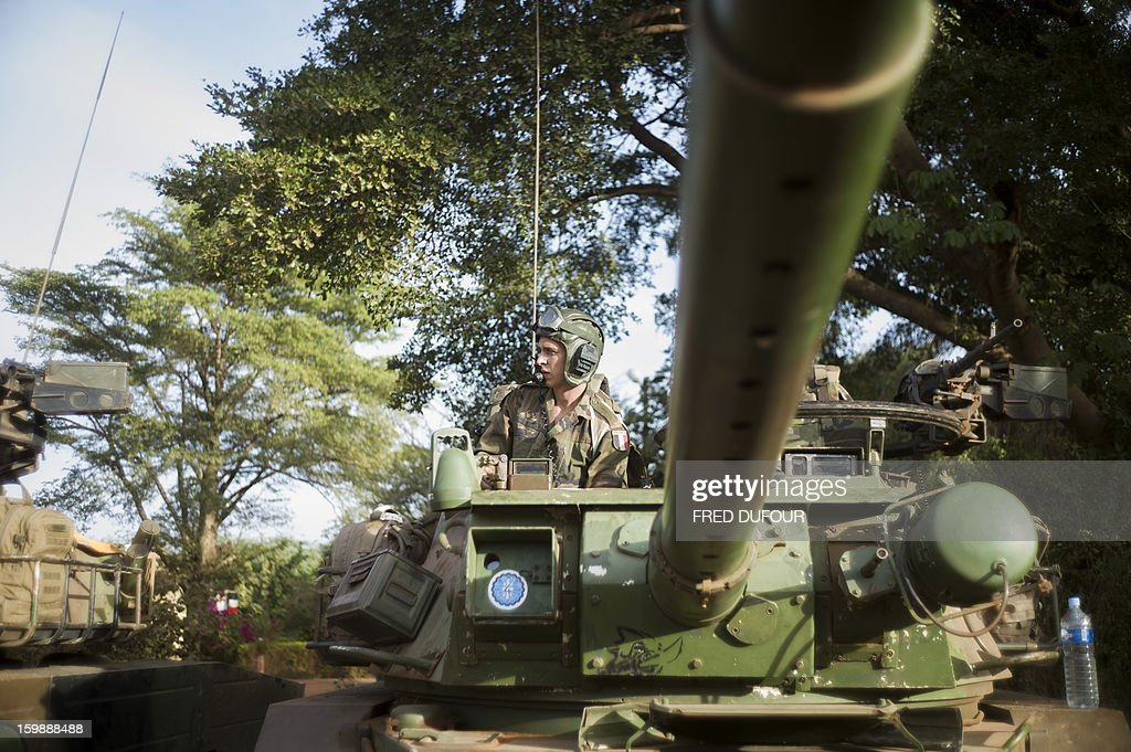 A French army soldier stands inside an armoured vehicule as he prepares to leave a base camp in Sevare, on January 22, 2013. Mali's army chief today said his French-backed forces could reclaim the northern towns of Gao and fabled Timbuktu from Islamists in a month, as the United States began airlifting French troops to Mali. AFP PHOTO / FRED DUFOUR