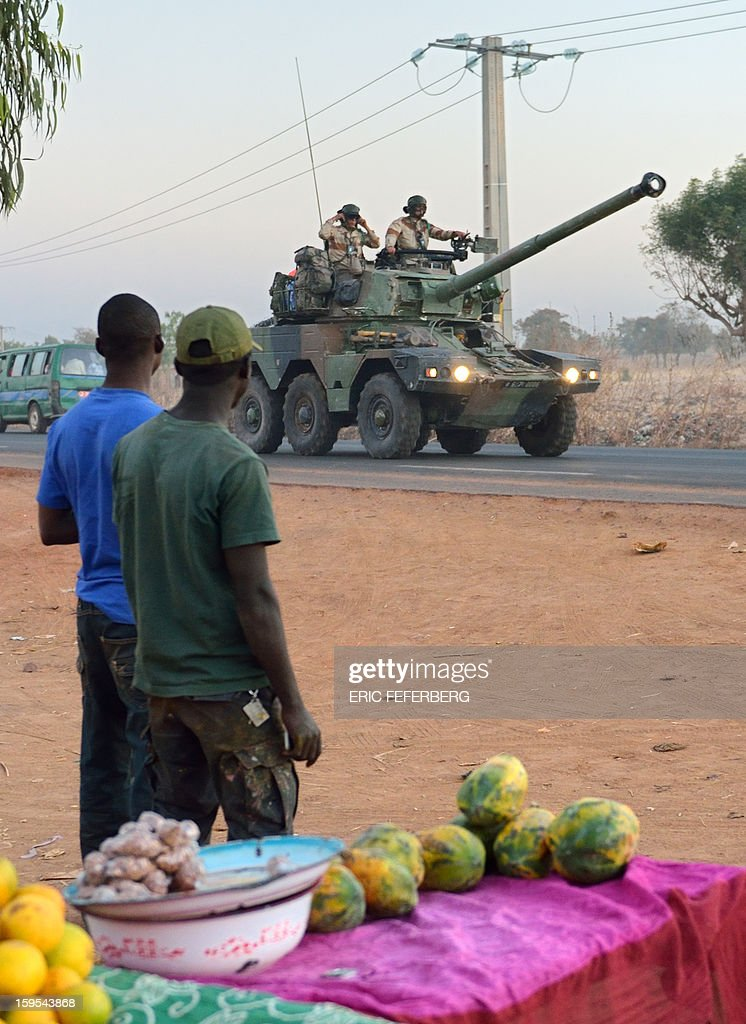French army soldiers stand on a Sagaie tank destroyer as they leave Bamako and start their deployment to the north of Mali as part of the 'Serval' operations on January 15, 2013 . France is using air and ground power in a joint offensive with Malian soldiers launched on January 11 against hardline Islamist groups controlling northern Mali.