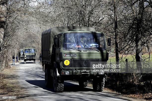 French Army trucks carrying gendarmes and investigative teams return on March 30 2015 to SeynelesAlpes from the crash site of the Germanwings Airbus...