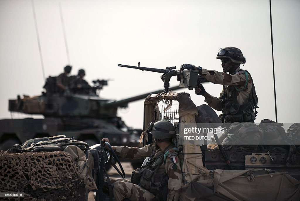 French army units take position outside Sevare, on January 23, 2013. Mali's army chief said today his French-backed forces could reclaim the northern towns of Gao and fabled Timbuktu from Islamists in a month, as more offers of aid poured in for the offensive. AFP PHOTO / FRED DUFOUR