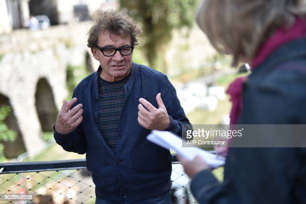 French art director Jean Blaise talks to a journalist on June 29 2017 in Nantes western France during the 6th edition of the 'A journey to Nantes'...