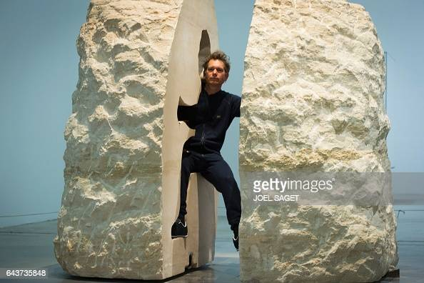 French artist Abraham Poincheval performs 'Pierre' at the Palais de Tokyo on February 22 2017 in Paris Poincheval will perform 'Pierre' during which...