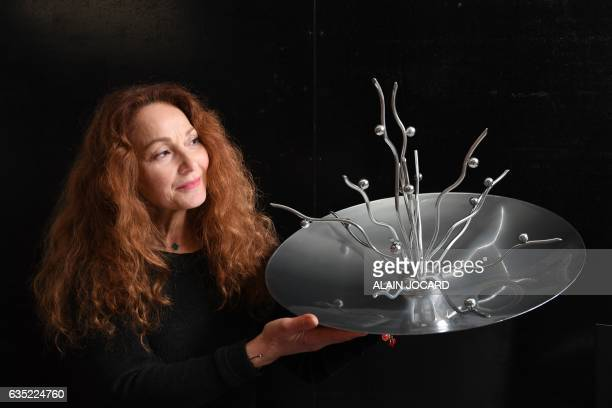 French artist Anilore Banon presents her sculpture entitled 'Vitae' that will be sent into space by the next 'Space X' shuttle flight on February...
