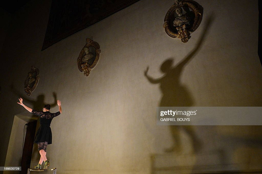 French artist Cecile Metral, member of the Femmes de Cirque company performs, walks on a cable in Rome on January 14, 2013 during the Quel Cirque 's show to promote the contemporary circus.
