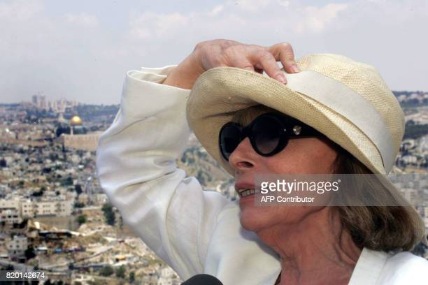 French artist Clara Halter holds her sun hat as she takes part in the inauguration of her exhibition 'Peace Tents' opened by French Foreign Minister...