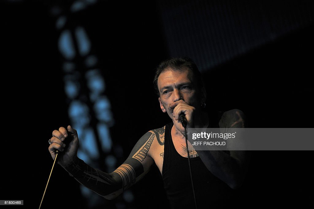 French artist <a gi-track='captionPersonalityLinkClicked' href=/galleries/search?phrase=Daniel+Darc&family=editorial&specificpeople=663118 ng-click='$event.stopPropagation()'>Daniel Darc</a> performs on stage, on July 5, 2008 in Belfort, eastern France, during the 20th edition of the French rock festival 'Les Eurockeennes de Belfort'. The music festival takes place in Belfort from July 4 to July 6, 2008. AFP PHOTO / JEFF PACHOUD