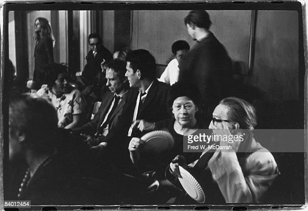 French artist Marcel Duchamp sits in an audience near American composer John Cage and his longtime companion dancer Merce Cunningham as they attend...