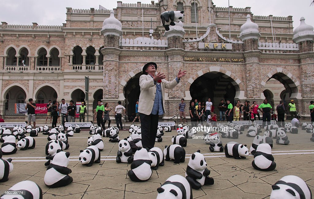 French artist Paulo Grangeon created Panda sculptures is seen throw a Pandas during photo call at 1600 Pandas World Tour in Malaysia on December 21, 2014 in Kuala Lumpur, Malaysia. 1600 pandas made by French artist Paulo Grangeon jointly with WWF with recycled paper are being exhibited in Kuala Lumpur. The paper-made panda exhibition aims at advocating more people to participate in protecting endangered animals.