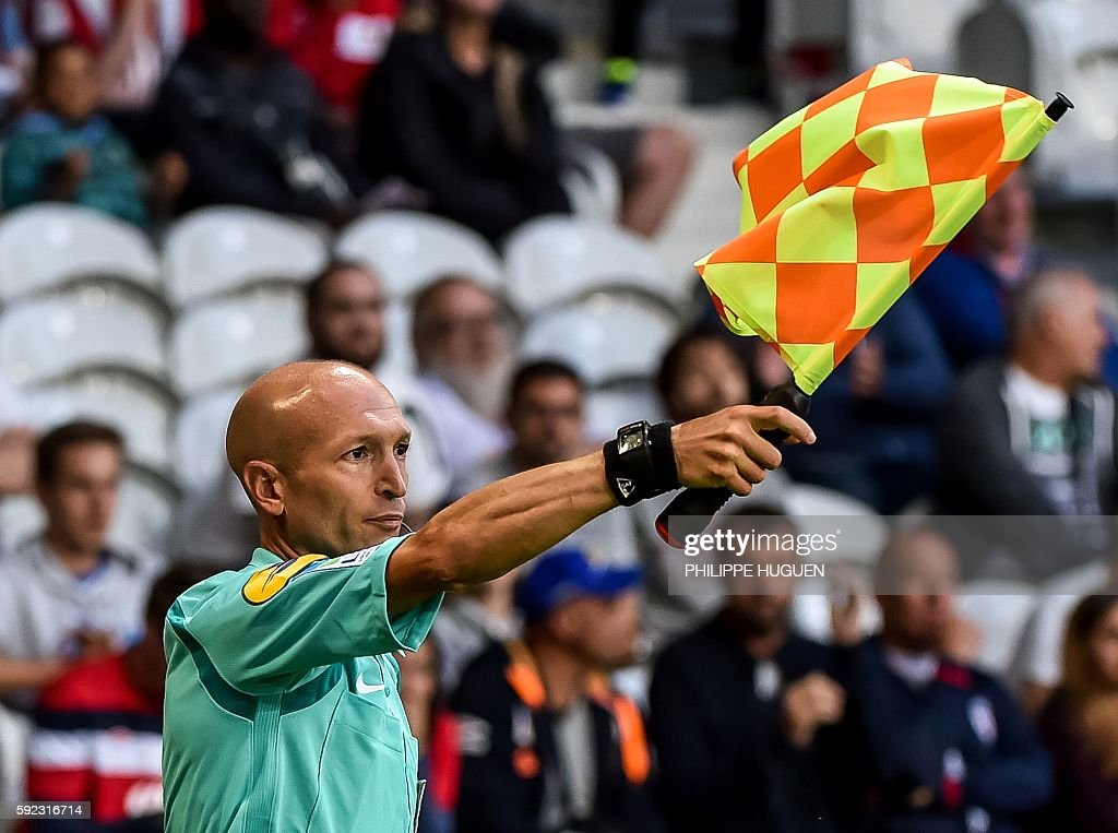 French assistant referee Cyril SaintCricq Lompre gestures during the French Ligue 1 football match between LOSC Lille and Dijon FCO on August 20 2016...